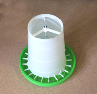 Gravity feeder with anti-flick guard